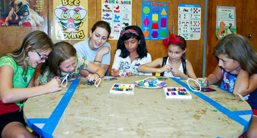 Art teacher Chrissy Lorusso Shelley, third from left, helped students Lily Bennett, Katie Moulder, Bianca Yepez, Katherine Viggiano and Grace Cassarello with their crafts as they made sun catchers.