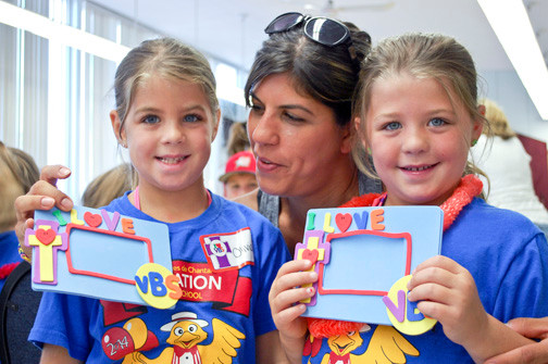 Andrea Clarkson admired the photo frames completed by her twin 6-year-olds, Olivia, left, and Abigaile.