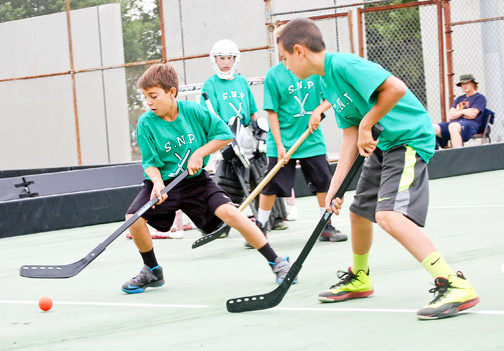 Players from Seaman�s Neck squared off against a team from Veterans Memorial Park in East Meadow during the 21st annual street hockey tournament.