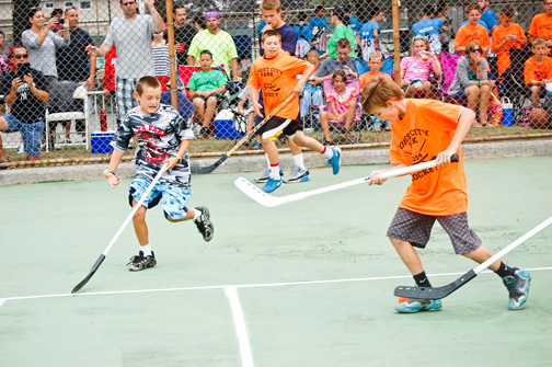 Forest City Park, in orange, competed in the street hockey tournament.
