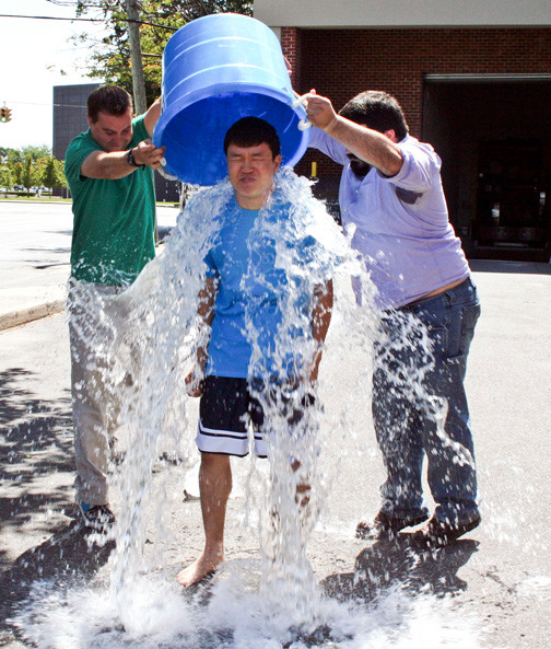 Herald intern Jimin Kim took an icy bath, with the help of editors Andrew Hackmack, left, and Alex Costello, to combat ALS, on Aug. 18.