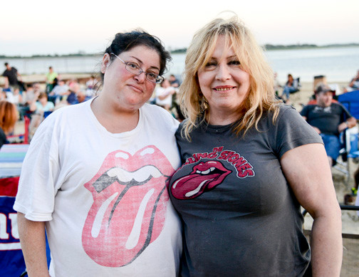 "Rolling Stone fans Nina Maltese and Eileen Domingo wore their ""Sticky Fingers"" T-shirts to the concert on the beach."