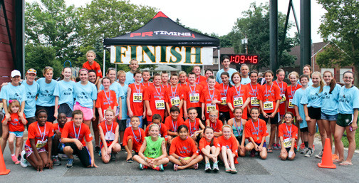 The participantS, volunteers and coaches after the Aug. 1 Fly With The Owls Middle School Triathlon program.