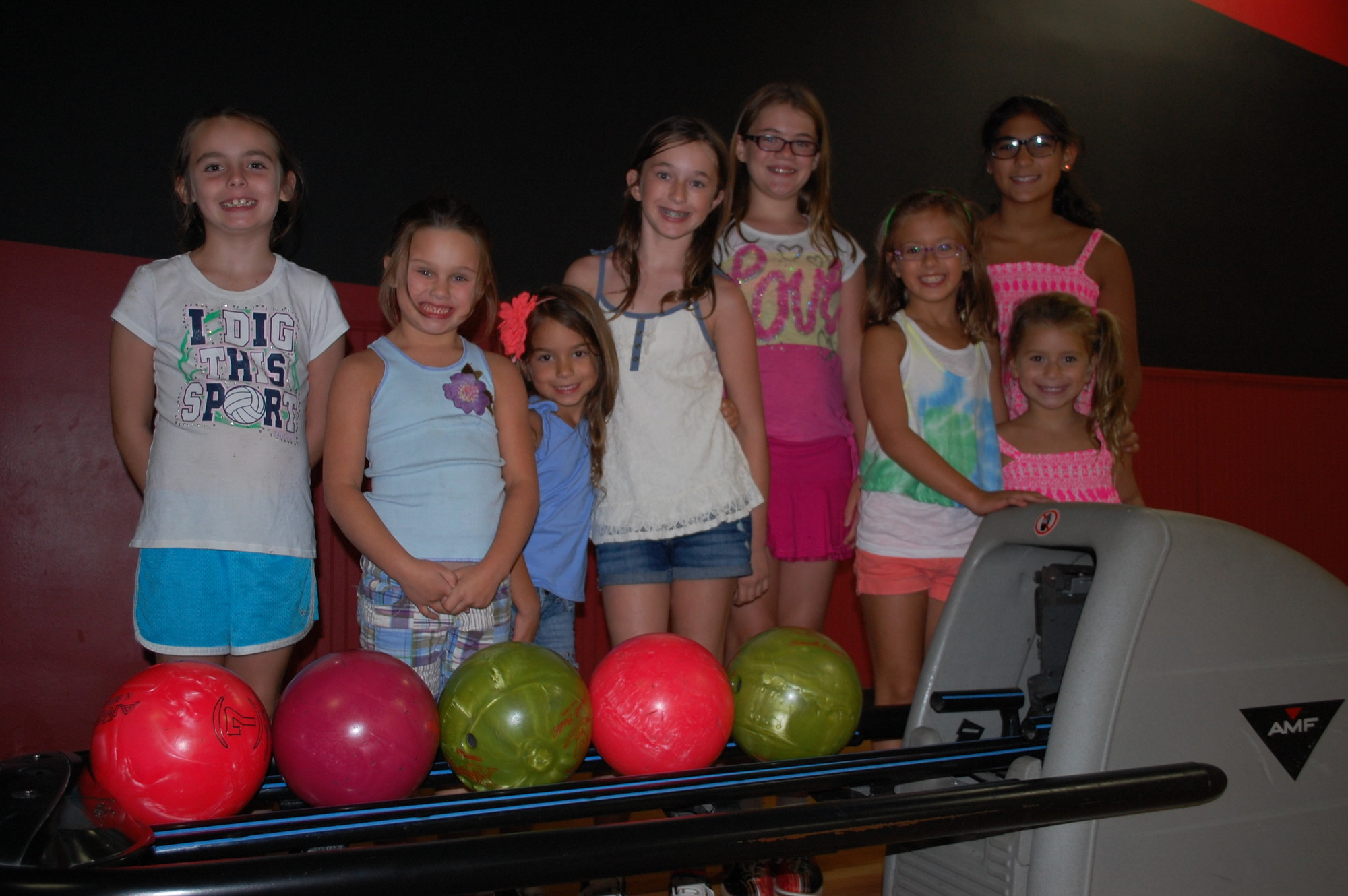 Children who participated in the Wantagh Public Library's summer reading program were invited to a bowling party last Friday evening. From left are Kaitlin Dillon, Madison Allan, Sophia Cornella, Samantha Allan, Lily Bennett, Alexandra Corrella, Alexa Gottlieb and Addison Gottlieb.