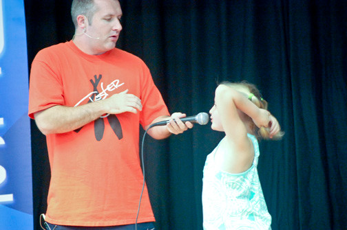 Daniela Brock assisted Jester Jim at the beginning of his performance on Aug. 15 at the Seaford Harbor School for children who took part in the library's summer reading program.