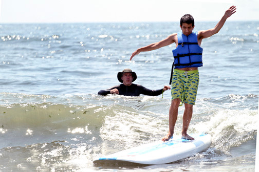 The Tommy Brull Foundation's Keith Lucchese looked on as Joey Ellul rode a wave.