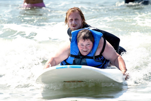 "With the help of Mike ""OC"" O'Connor, wheelchair bound Gina Barbara makes her surfing debut."