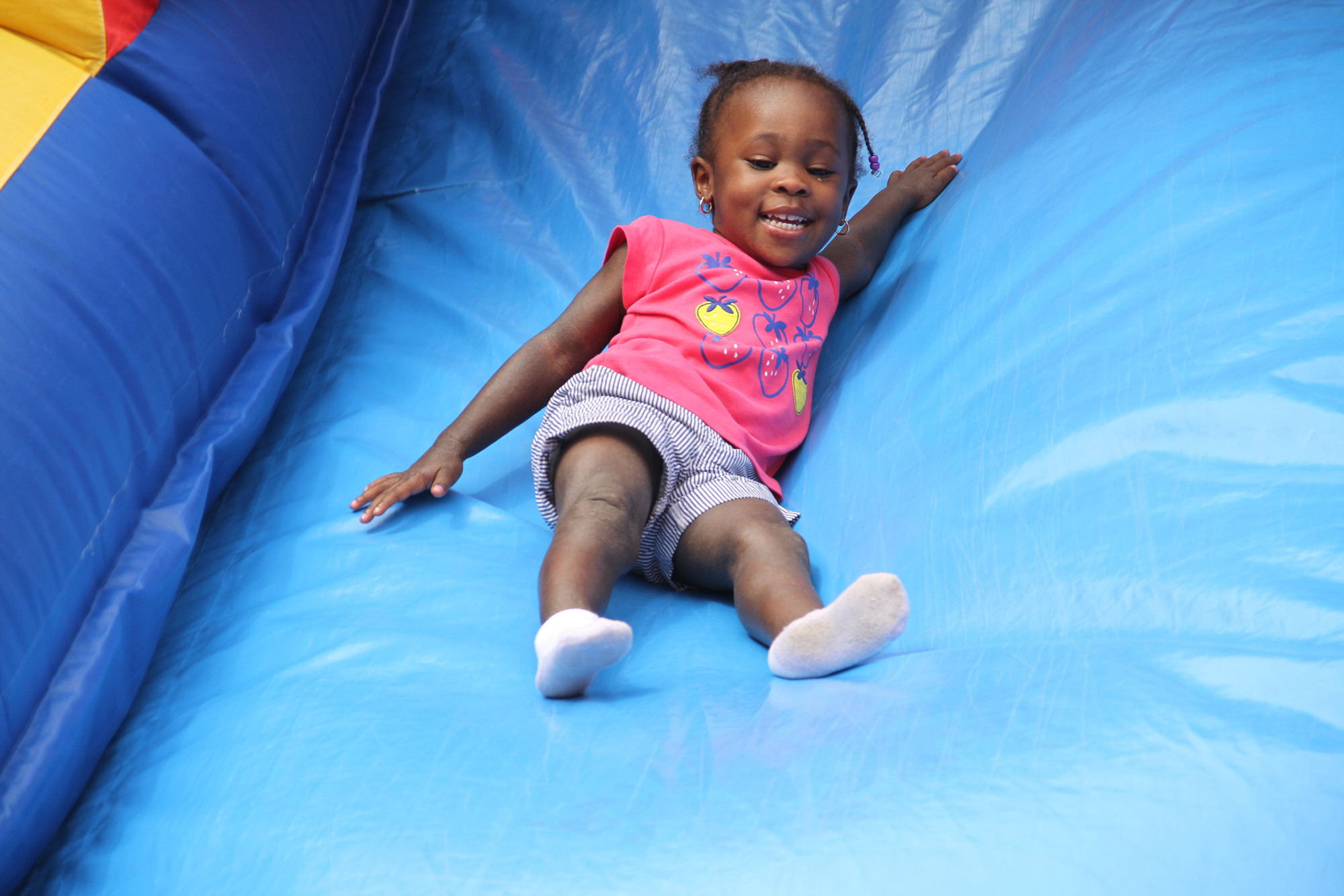 Shaliyah Lewis bounced down the giant slide.