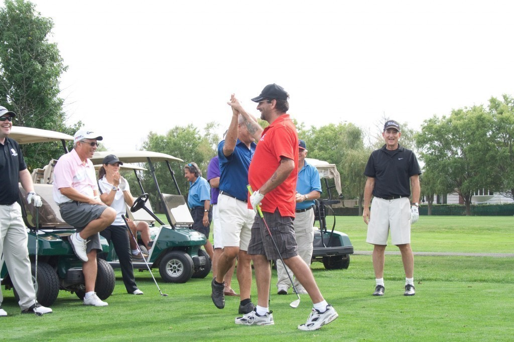 Lawrence Yacht & Country Club members hosted several members of the Wounded Warrior Project for a day of golf, tennis and fishing on Sept. 21. Military veteran Tom Amendola, left, was congratulated by Gary Segal after a great shot.