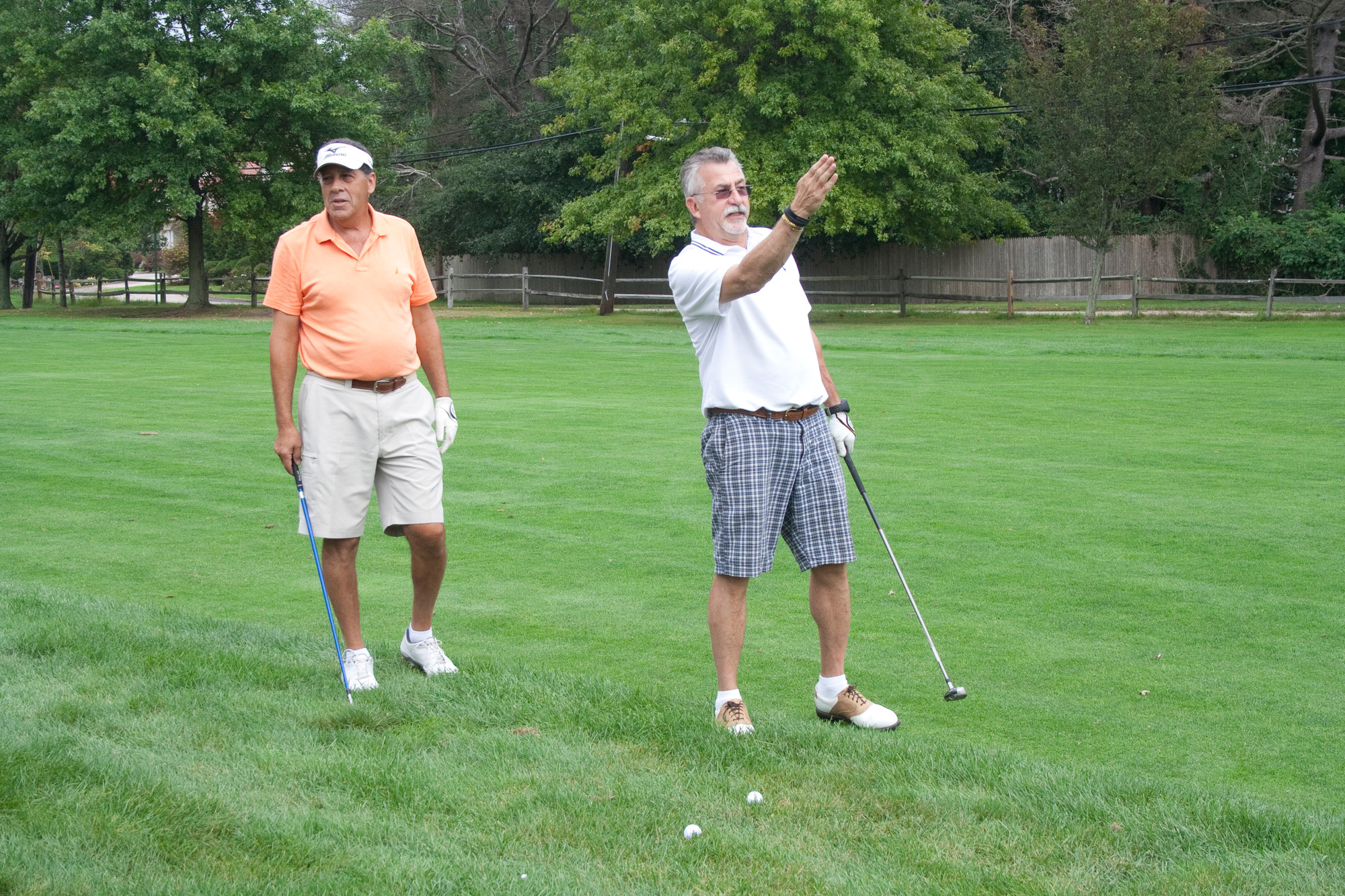 Lawrence Yacht & Country Club members partnered with the Wounded Warrior Project on a day of golf, tennis and fishing last Sunday. Above, Frank Bobby, right, lined up his shot, while Ed Henig waited his turn.