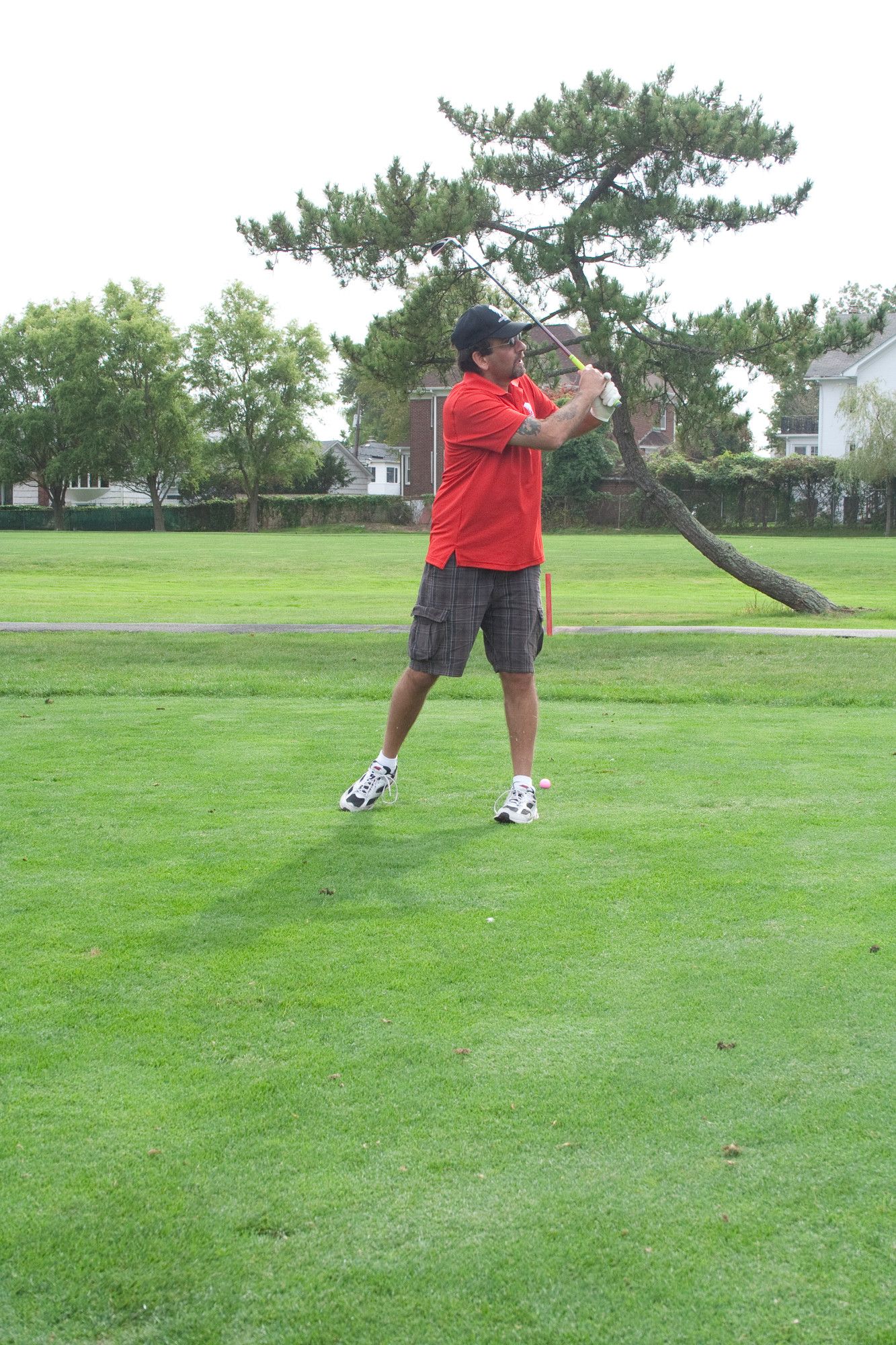 On the green at the Lawrence Yacht & Country Club, military veteran Tom Amendola followed through on his golf swing.