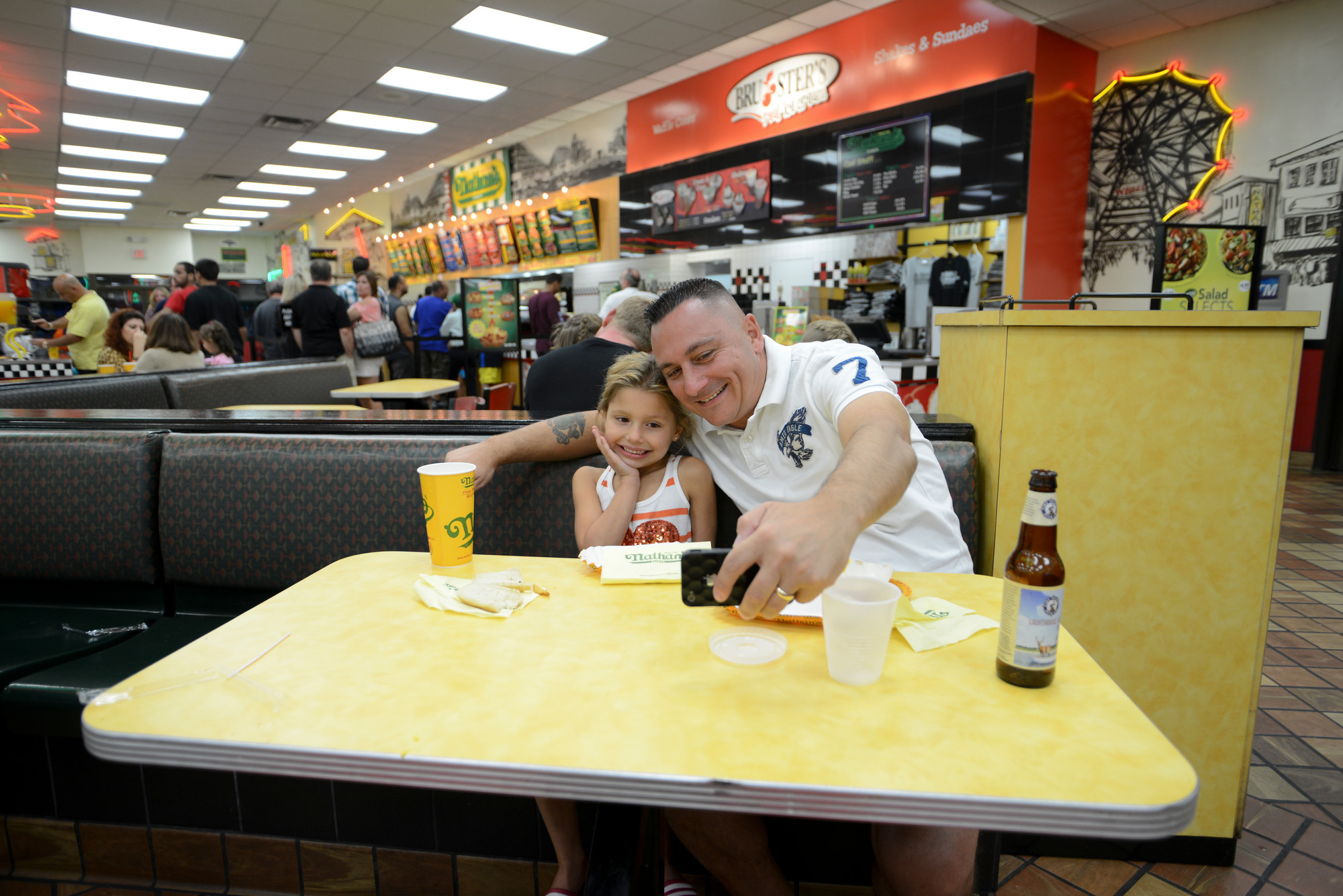 Ava and Frank Morizio took a selfie as they enjoyed their last taste of Nathan's.
