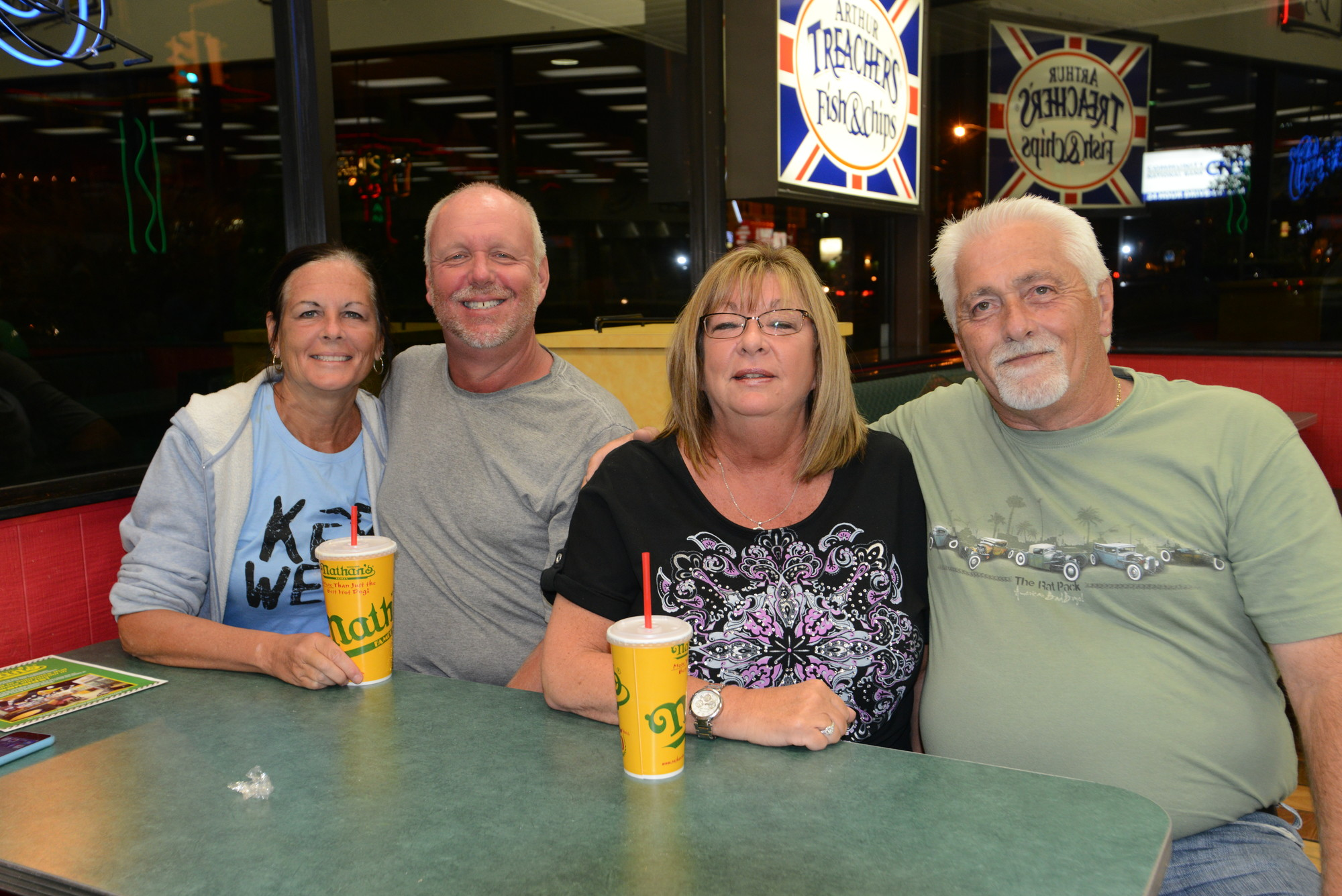 Double dating at Nathan's, just as they have since 1978, Diane and Glen China, left, and Andrea and Greg Johnson said goodbye to one of their favorite hangouts.