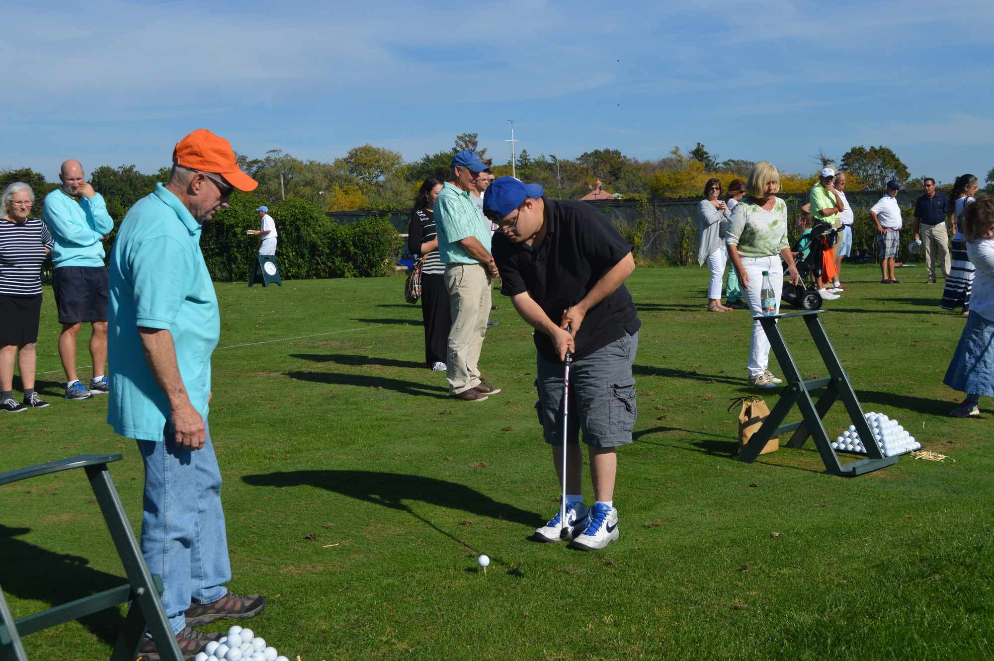 "JCC's ""Play Golf"" clinic provided the opportunity to learn how to play the game. Steve Hammerman, left, helped Adam Weingarten address the ball."