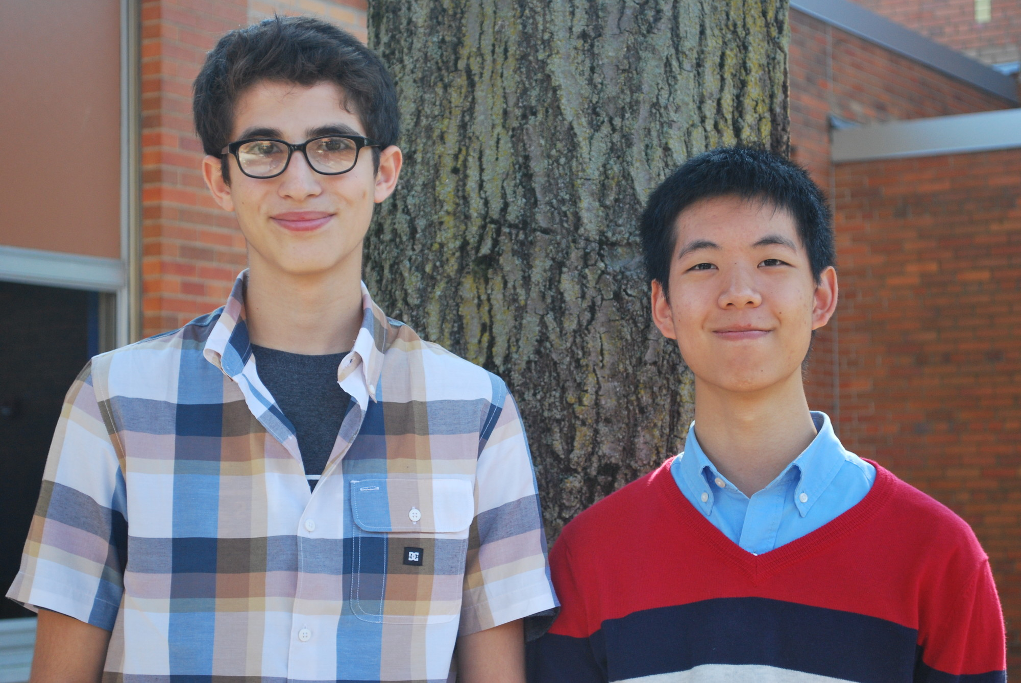 Lawrence High School students Lee Blackbuurn, left, and Arthur Chen, along with project partner Justin Lish of HAFTR, were named Sienens semifinalists.