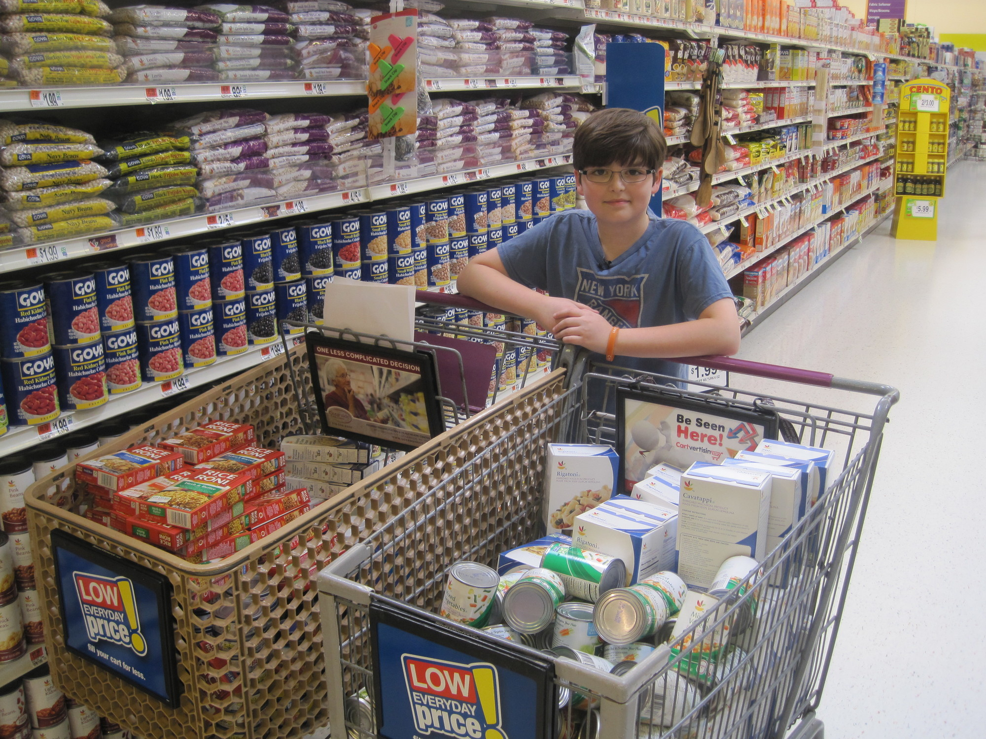 Cory Nichols shops for local food pantries.