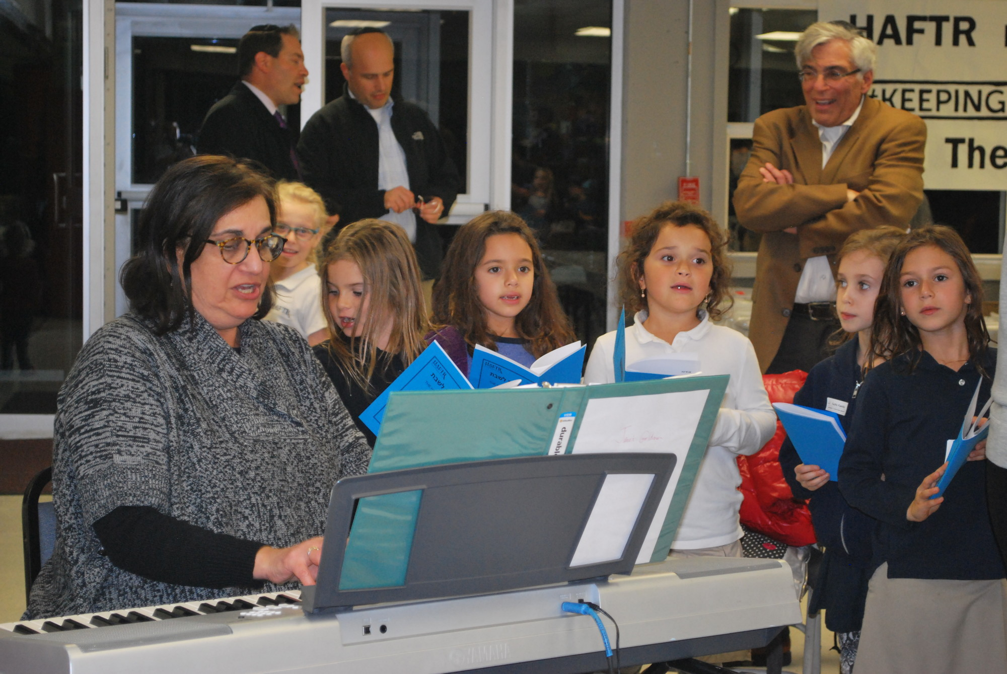 Music teacher Janet Goldman led the children through a few songs during the event.