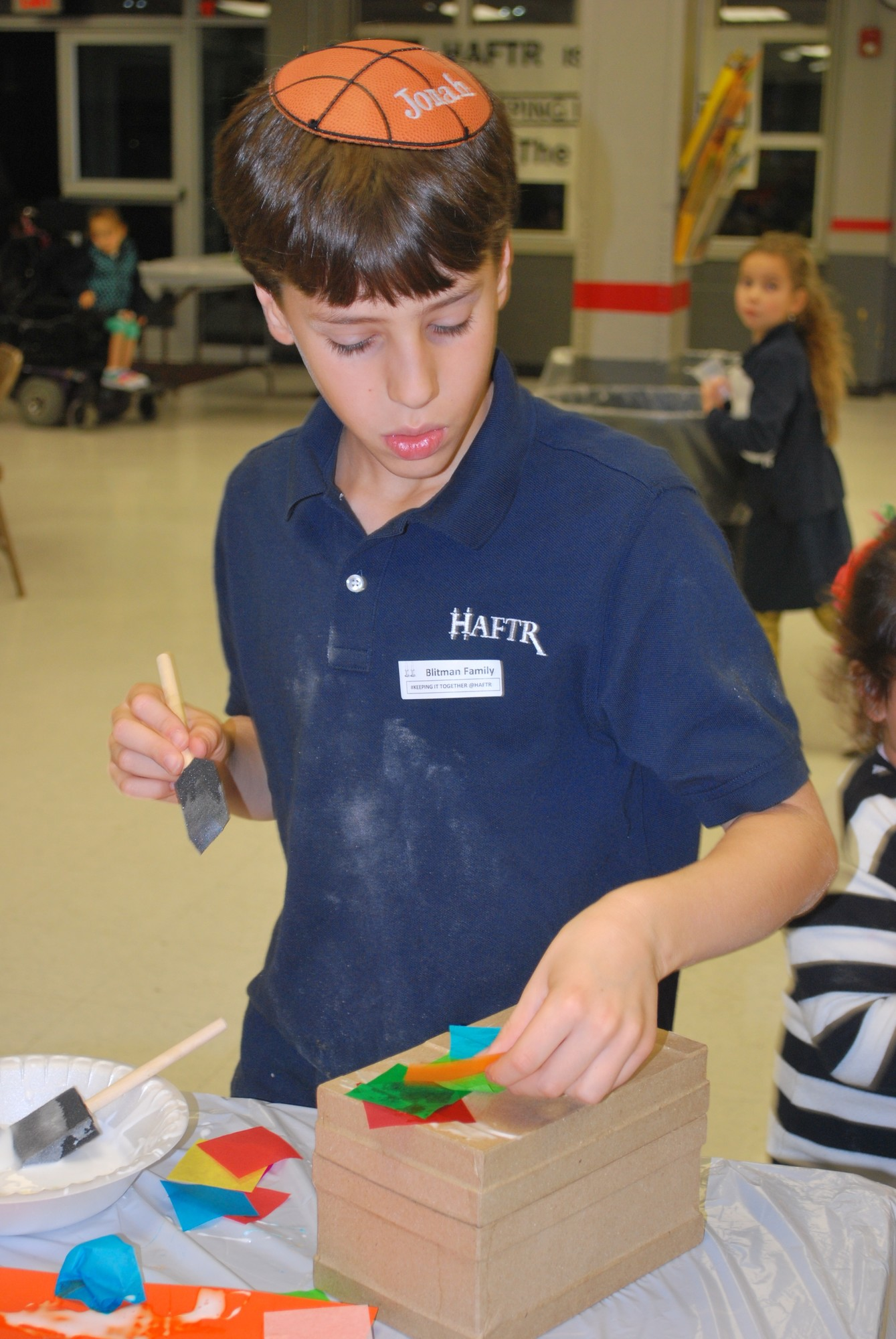 Other activities at HAFTR's challah bake included making muktzah boxes. Fourth-grader Jonah Blittman, 9, decorated his creation.