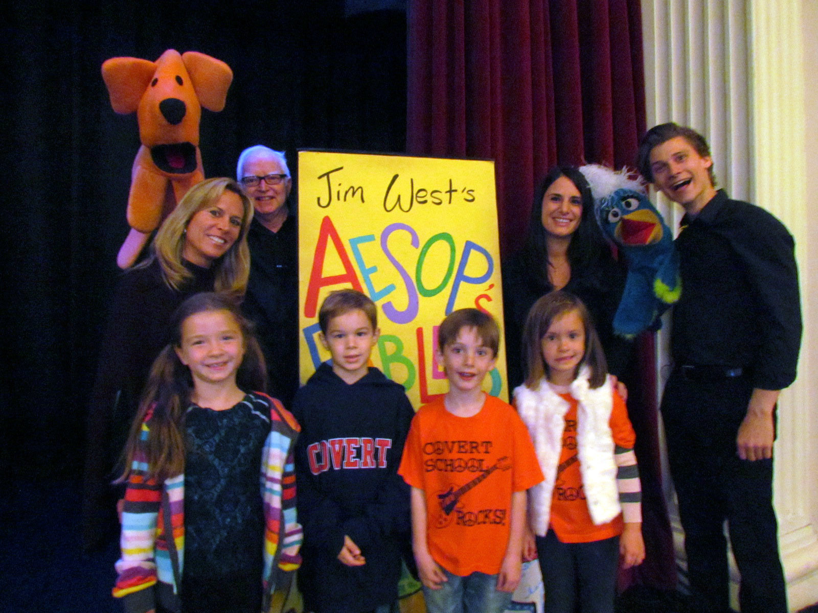 Teachers Valerie Sprague and Antoinette Morgan, and first graders Julie Coles, Joshua DePaoli, Connor Erickson and Liana McCarthy posed with puppeteers Jim West and Ian Antal before the show.