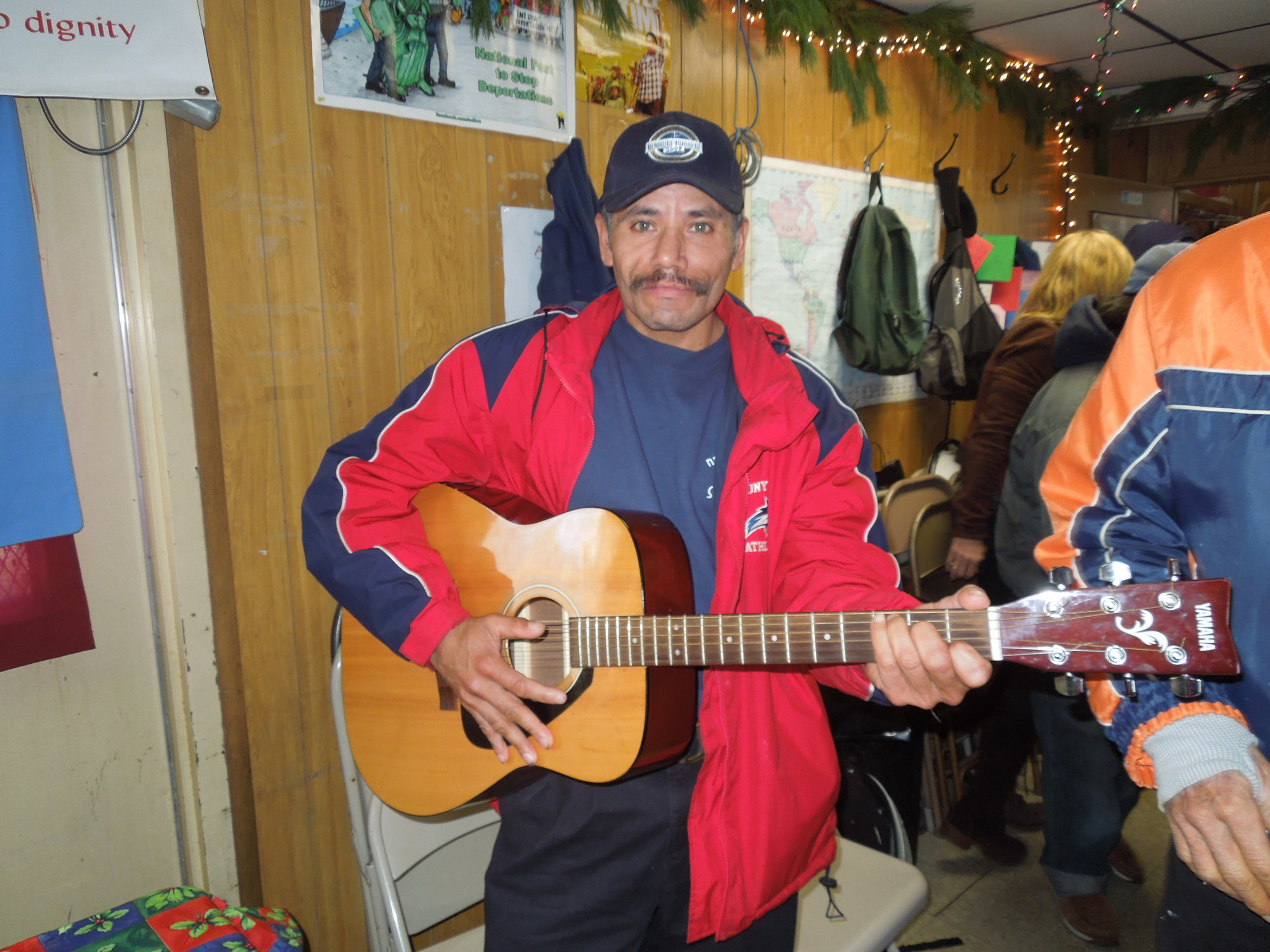 Victor played guitar at a Christmas party held at CoLoKi, the trailer in Freeport that provides assistance to day laborers.