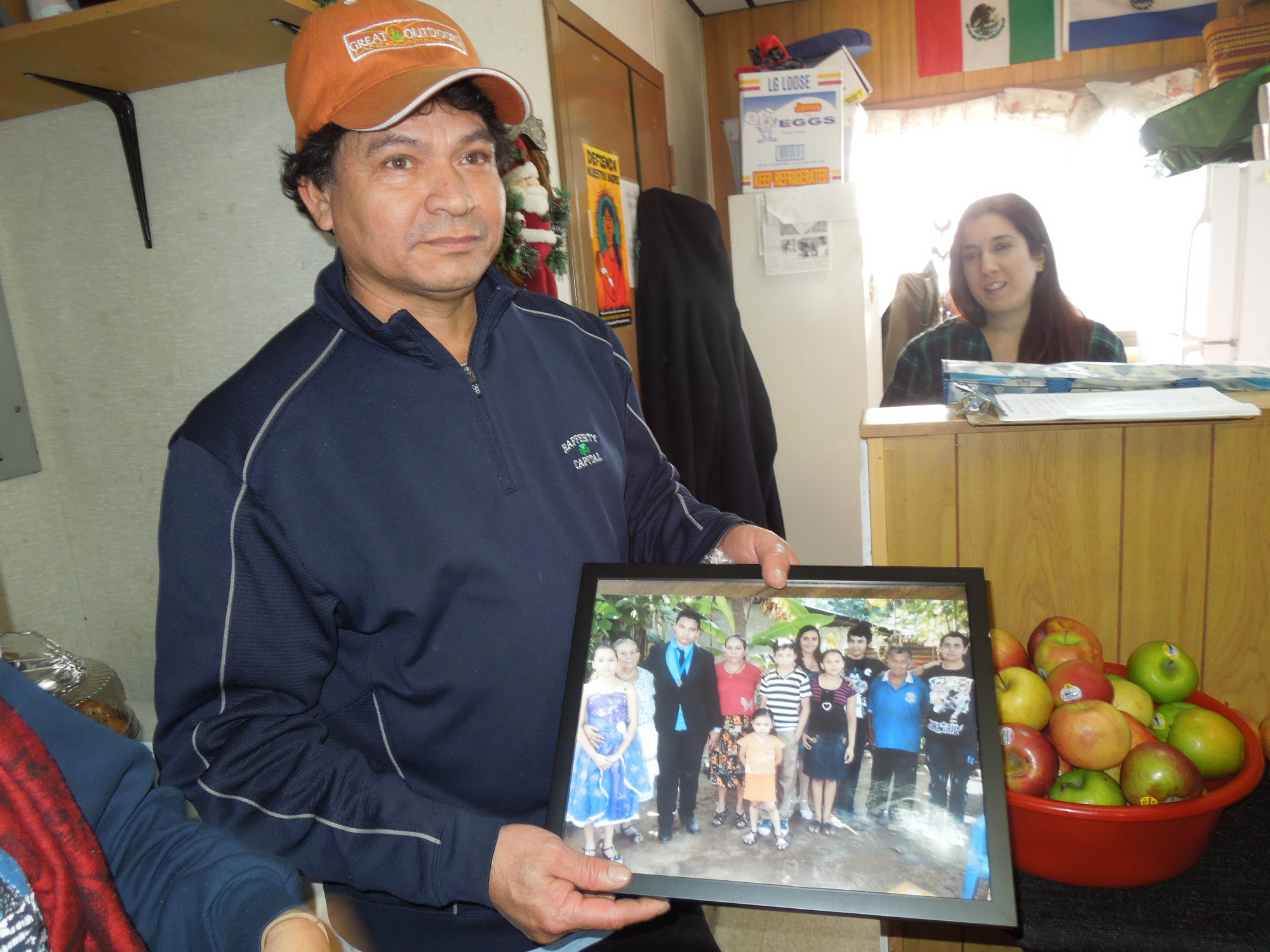Nicholas Diaz held a photograph of his family back in El Salvador. He sends money back home to support them.