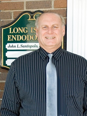 Woodmere-based endodontist John Santopolo played a large role in the merger of the Woodmere Merchants Association and Hewlett Business Association.