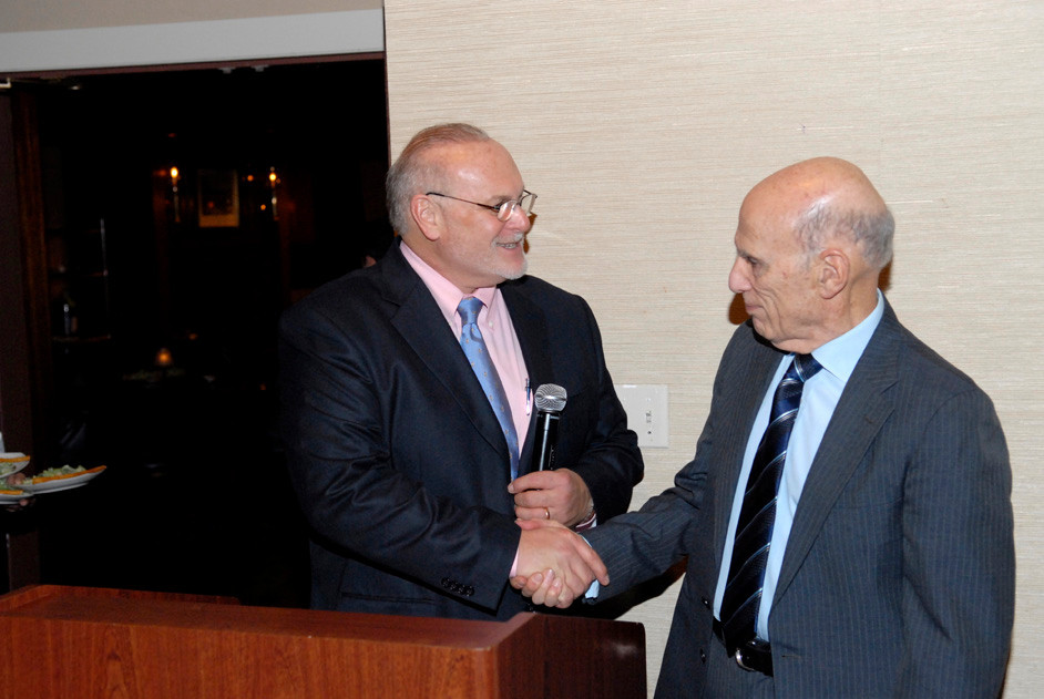 Dr. John Santopolo, left, and Joseph Gelb formally announced the merger of the Woodmere Merchants Association and the Hewlett Business Association that formed the Hewlett-Woodmere Business Association at a dinner at the Woodmere Club on Nov. 10, 2011.