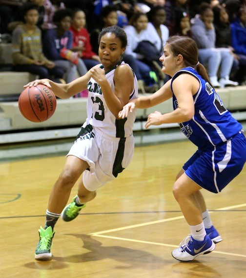 Elmont's Arielle Pierre, left, drove against Long Beach's Jaclyn Marry during last Friday's Conference AA-III game won by the Lady Spartans, 80-62.