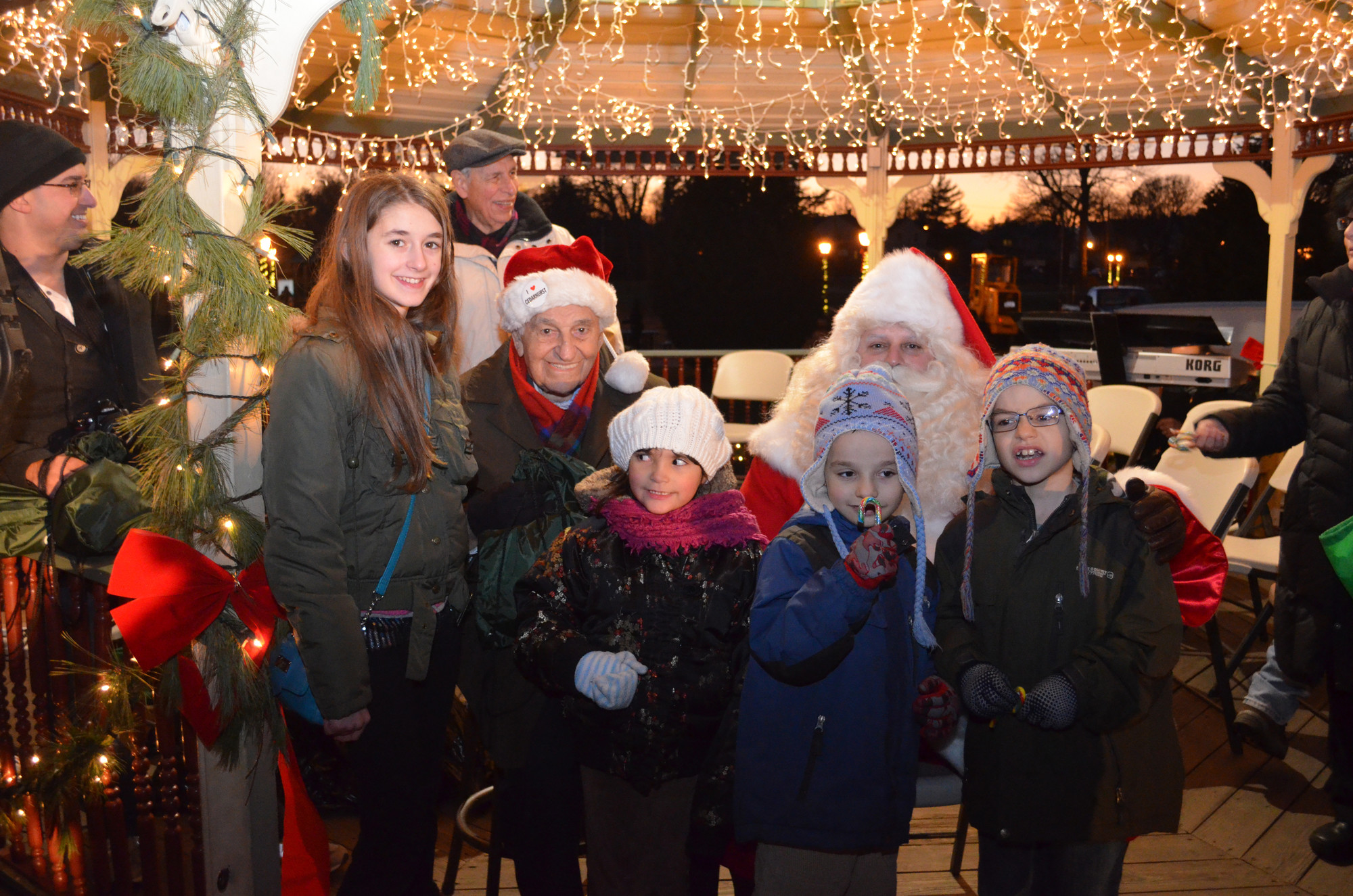Cedarhurst Mayor Andrew Parise could usually be found in the middle of any village event. From left, at last December's annual holiday celebration and tree lighting, were Silvia Carlo, Parise, Isabela Iasevoli, Mark and Matthew Iacomino, and Santa Claus.