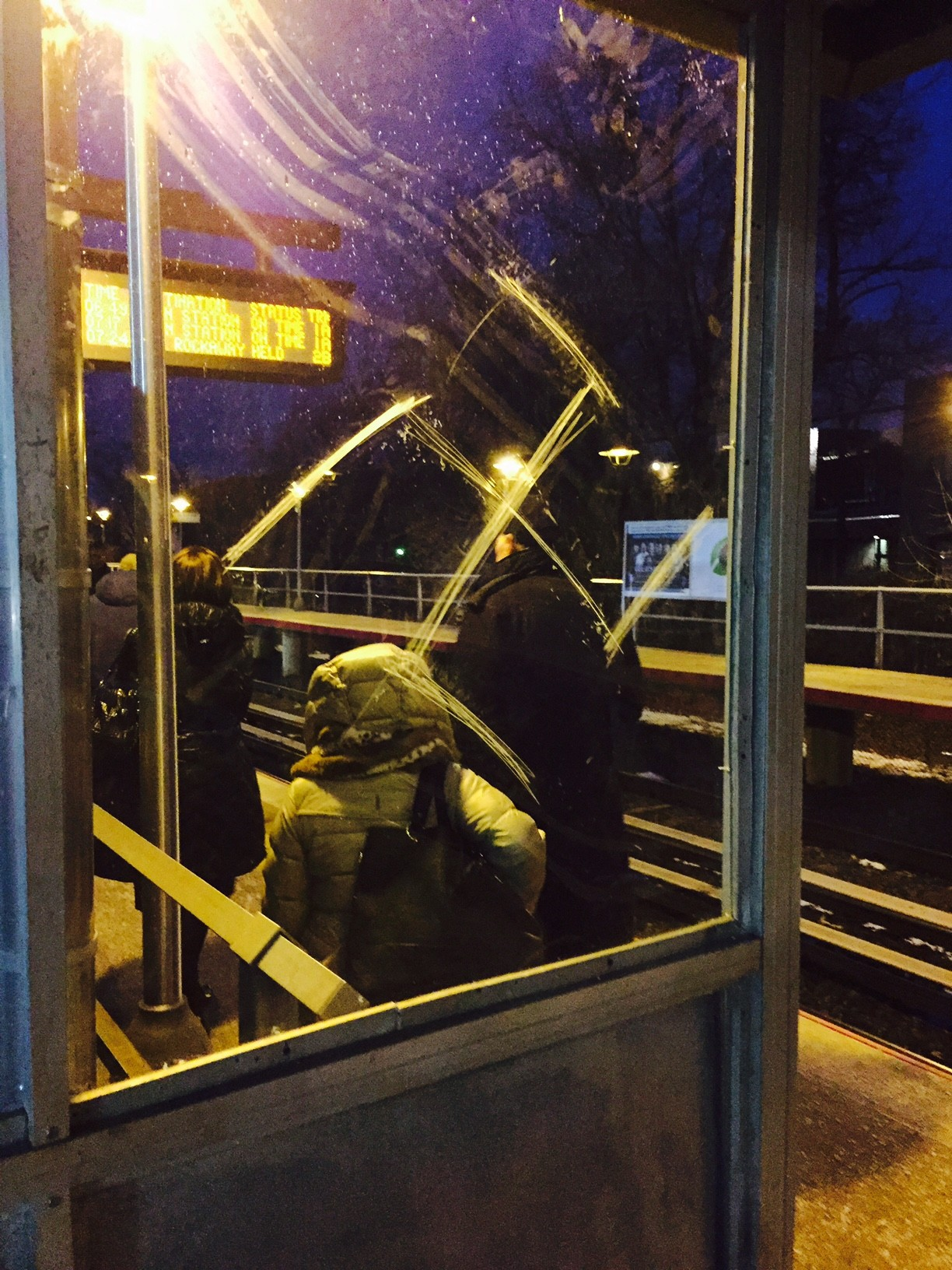Security cameras are to be installed at the Cedarhurst LIRR station later this year. Above, a platform shelter panel defaced last month.