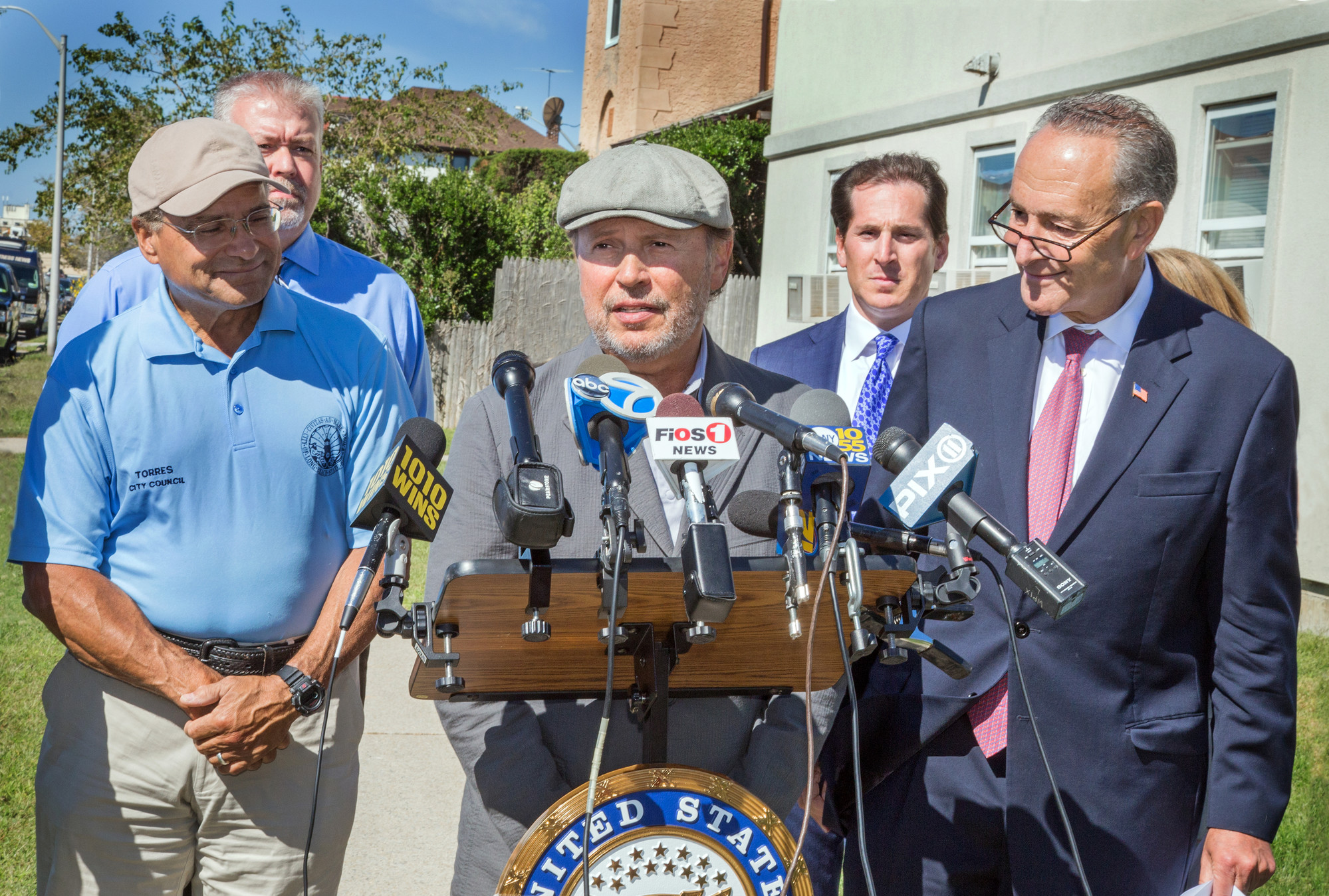 Billy Crystal and U.S. Sen. Charles Schumer with local officials in September.