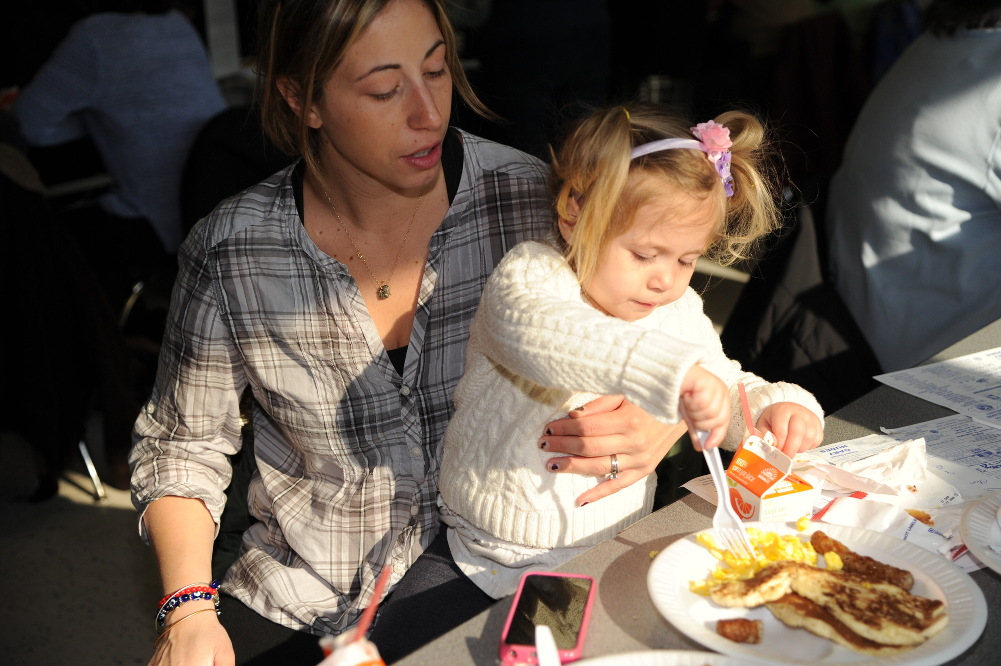 Jen Colucci, with young Nicolina, 2, chowed down.