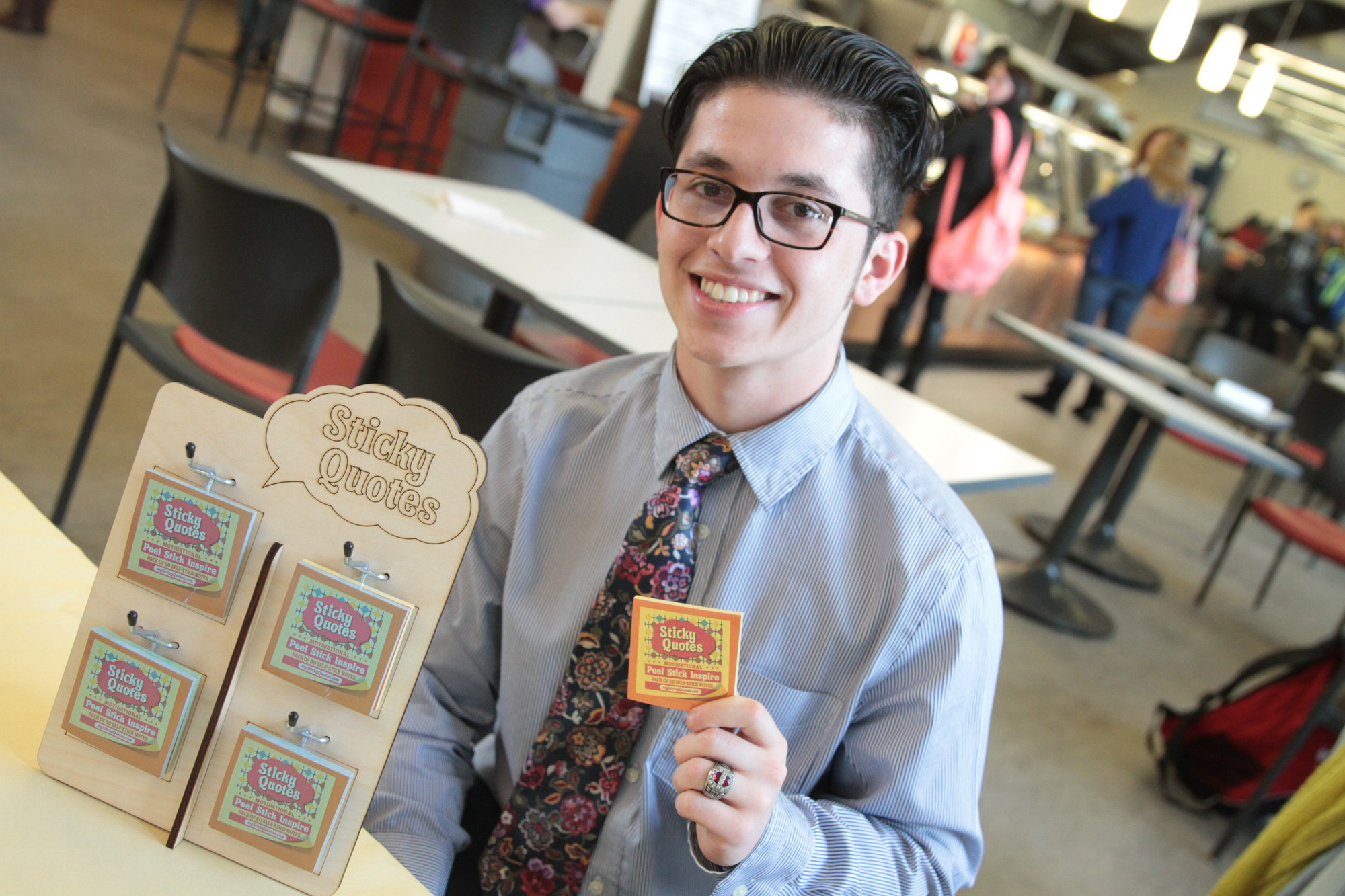 Molloy student Michael Russo sells sticky notes with inspirational sayings.