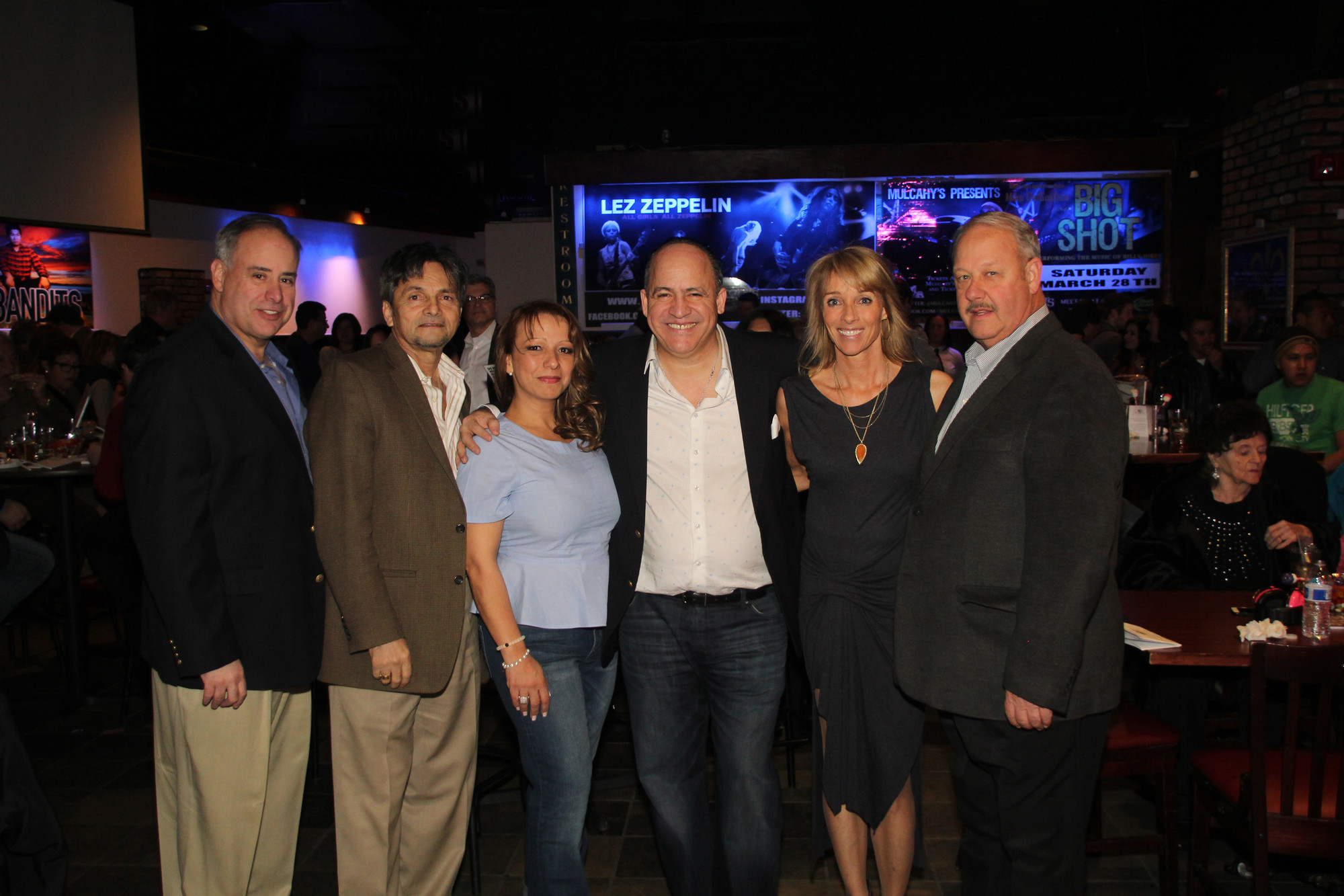 Freeport Chief of Police Miguel Bermudez, from left, Welquis Lopez, Elizabeth Londoño-Minier, Frank Minier, Freeport Trailer leader Liz O'Shaughnessy and Freeport Mayor Robert Kennedy.