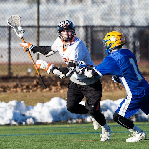 Carey's Tom Mayer, left, had a goal and four assists in the team's 11-3 victory over East Meadow in non-league action on March 23.