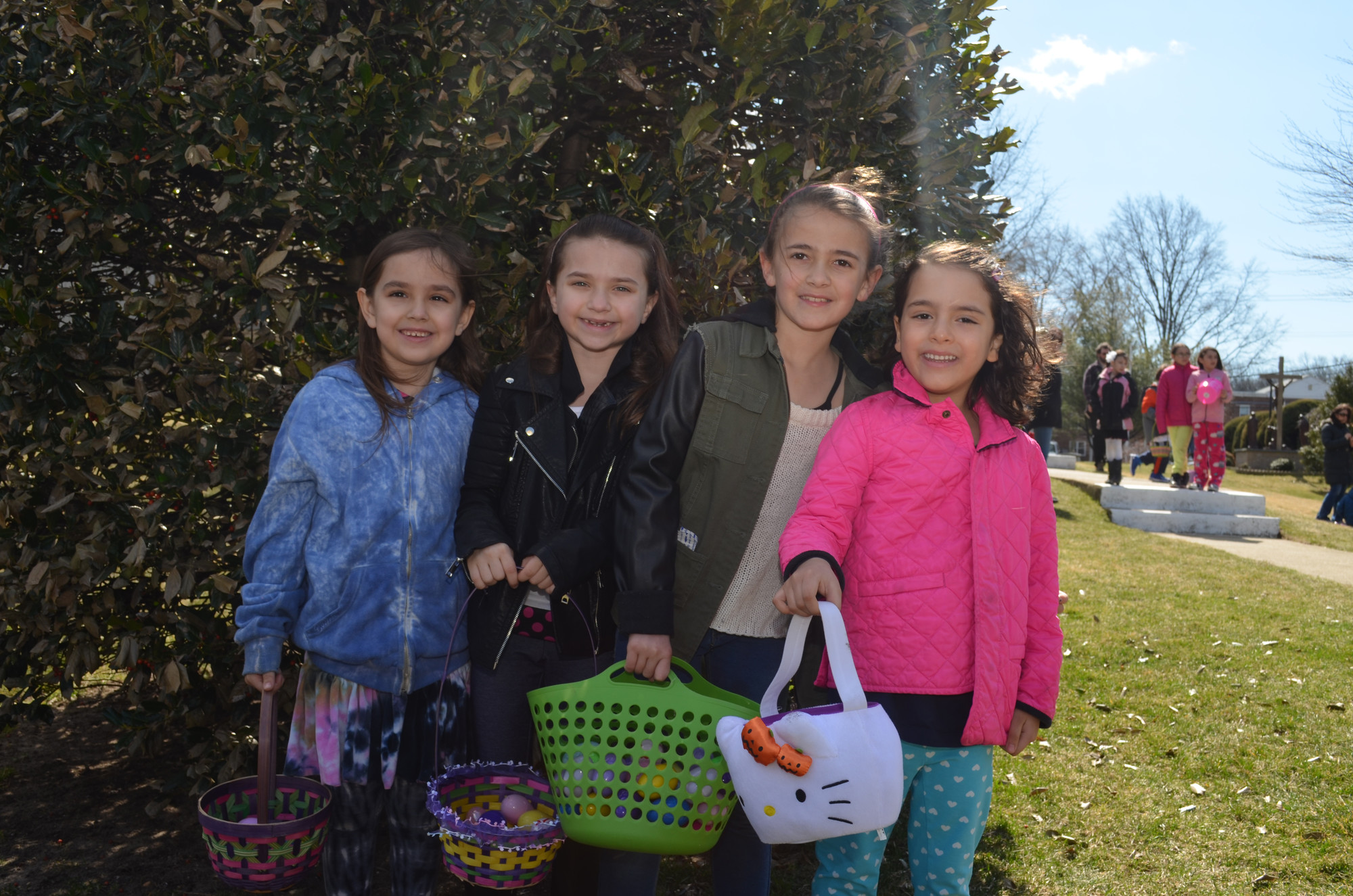 The egg hunt was good to sisters Lore, 6, Gabriella, 7, and Jule, 8, Villalba and friends Francesca Garcia Rocha, 6, all Hewlett residents as they showed off their baskets.