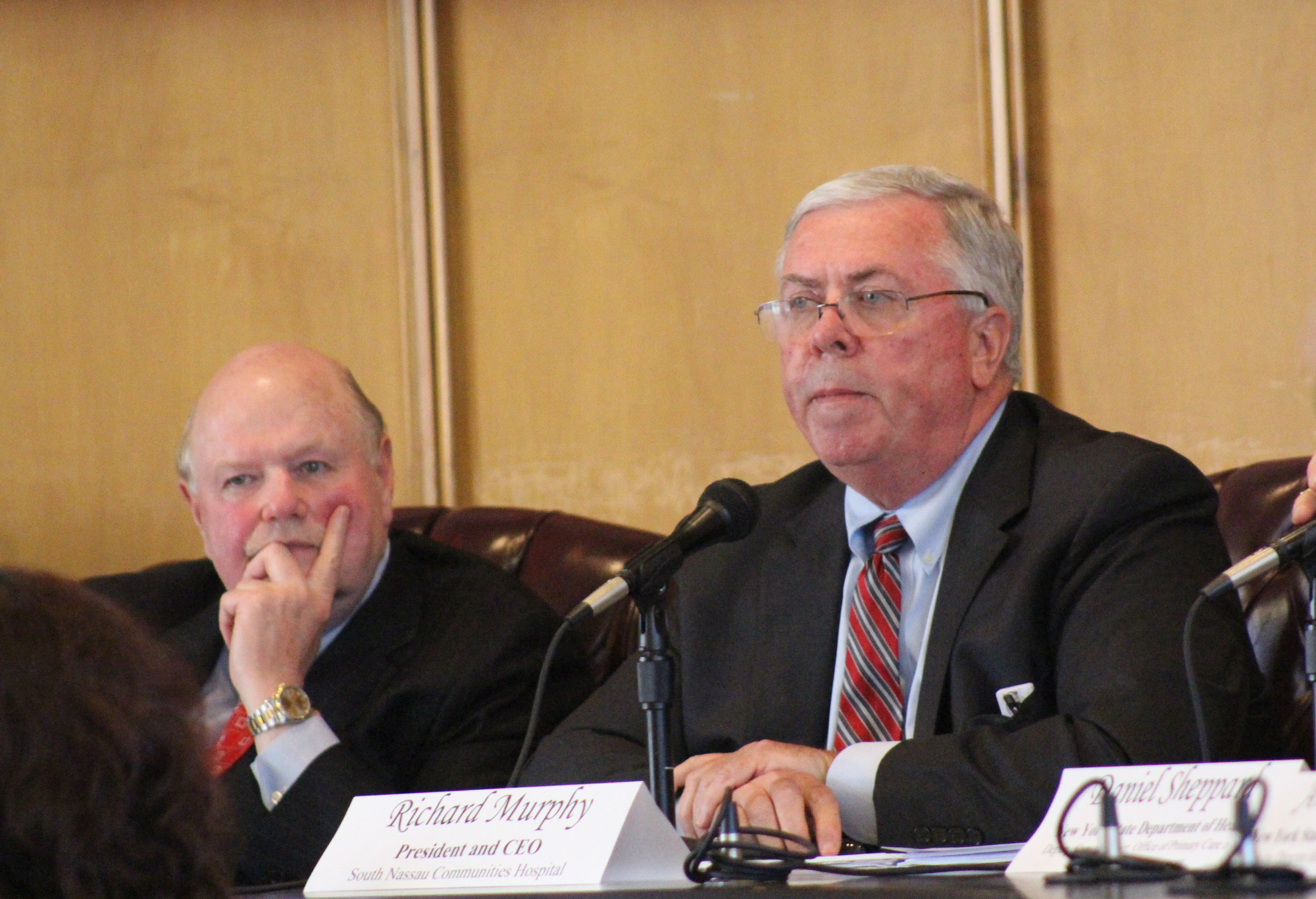 Joseph Fennessy, left, chairman of South Nassau's Board of Directors, and SNCH's President and CEO Richard Murphy listened to nearly 50 residents make their case for a full-service hospital in Long Beach.