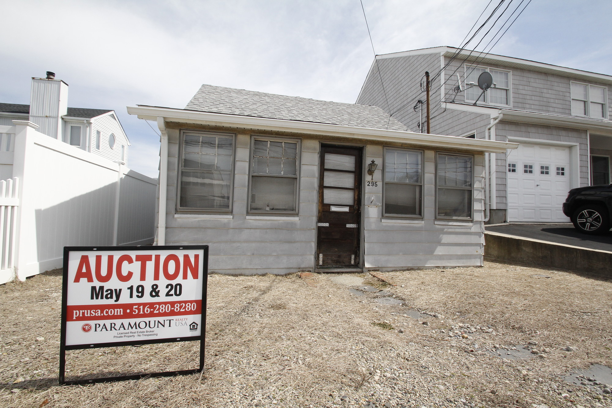 This waterfront house, on Arthur Street in Freeport, is one of 150 that will be up for auction in May.