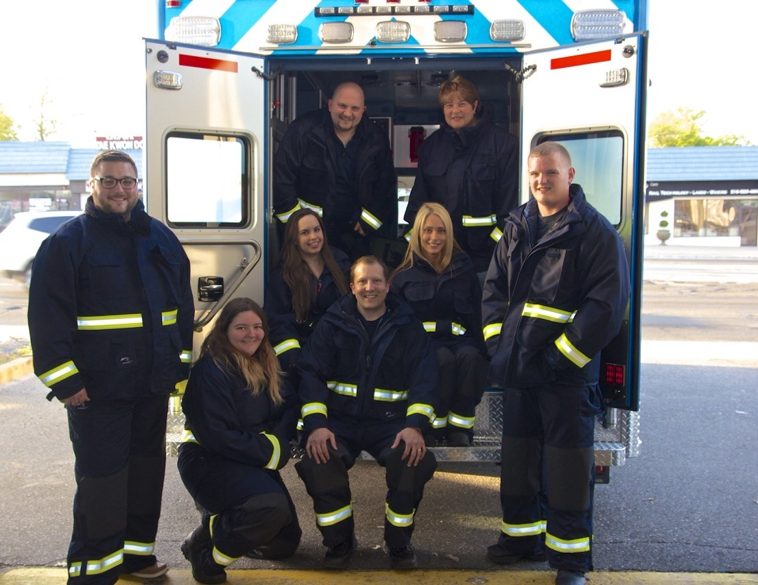Members of the Wantagh-Levittown Volunteer Ambulance Corps show off turnout gear purchased last year, similar to equipment the grant will fund.