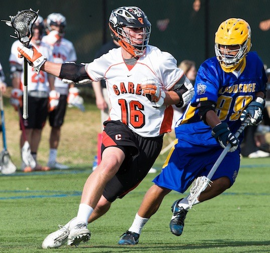 Carey's Mike Kadnar, left, who had two goals, worked against Lawrence's John Malfa during a Nassau Class B first-round playoff game on May 11.