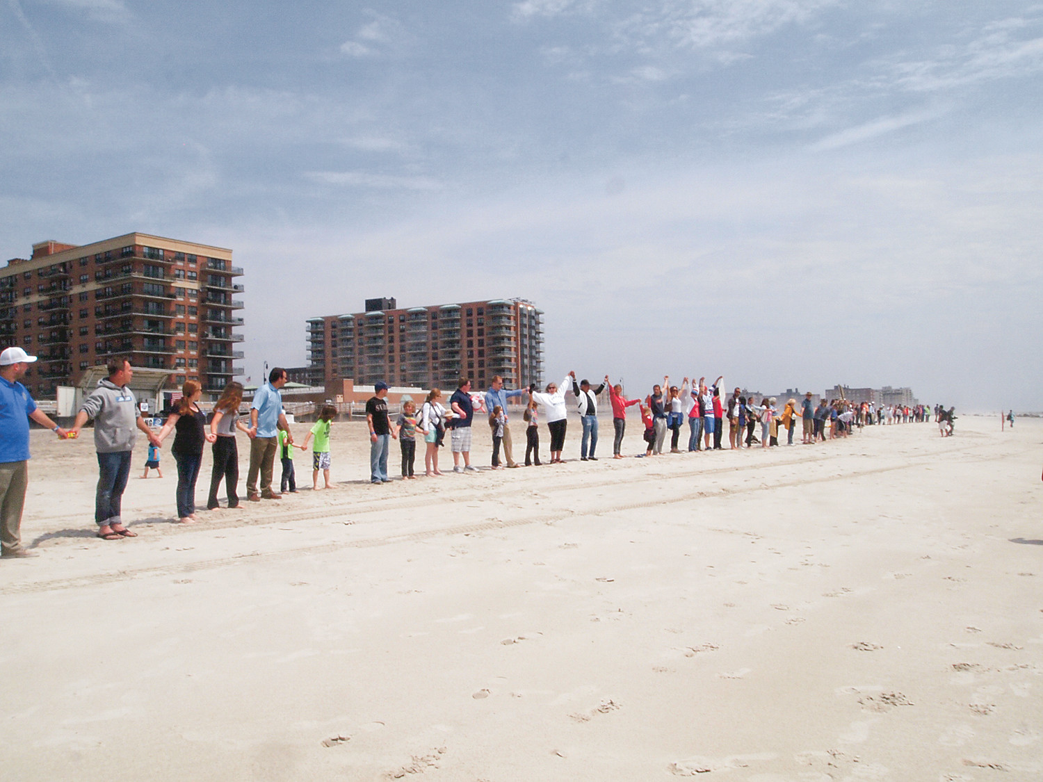 Residents, city officials and environmental groups locked hands for 15 minutes in protest of Port Ambrose.