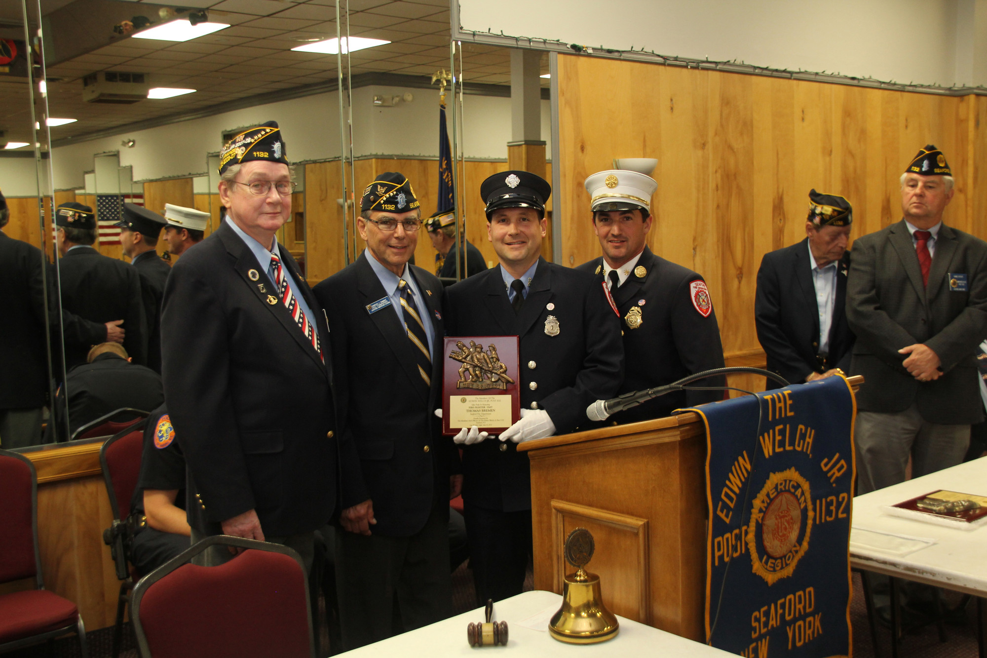 Thomas Bremen, a Seaford firefighter and AMT, accepted a Legion Law and Order award for his life-saving actions.