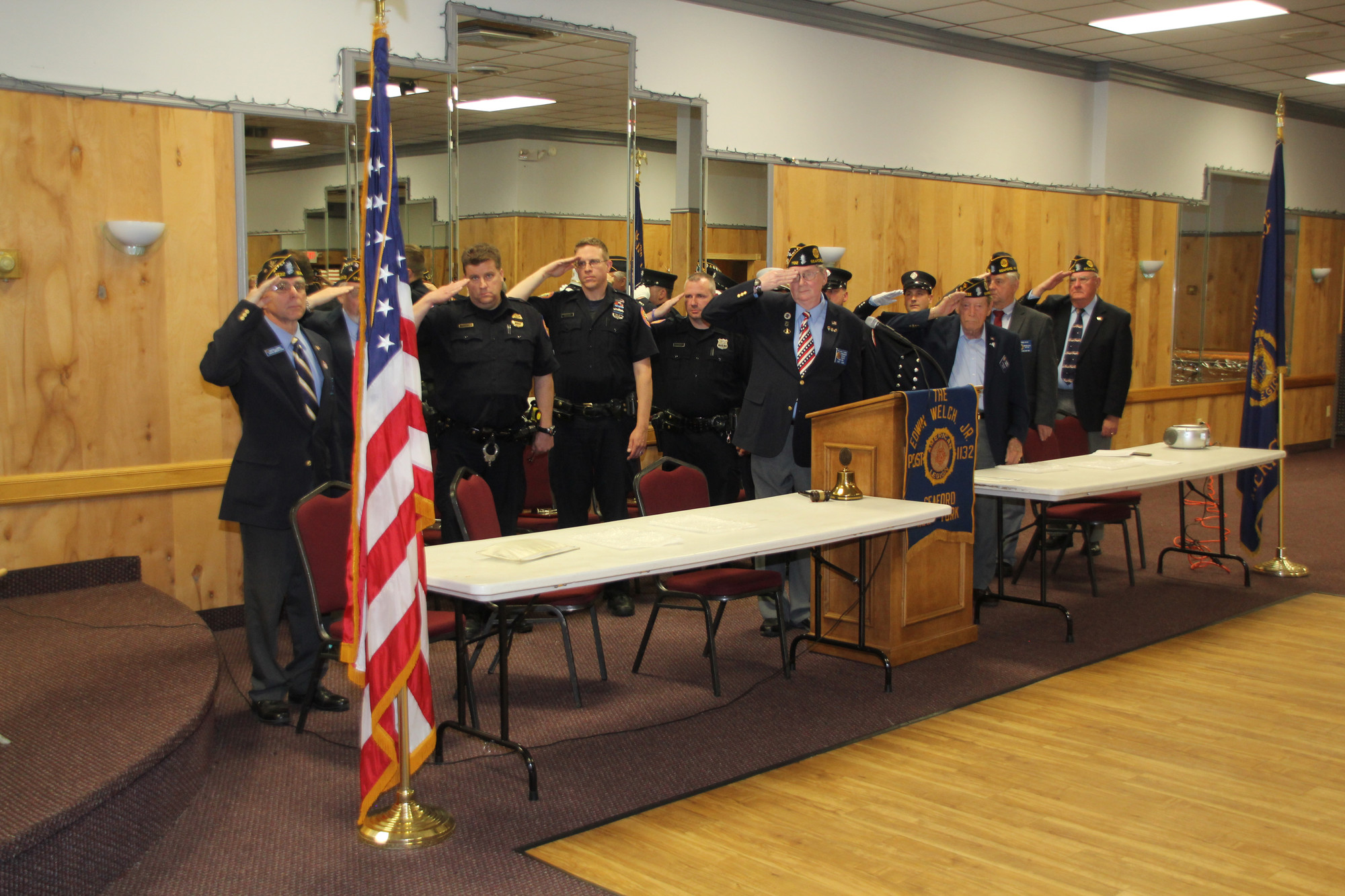 Members of the American Legion and honorees saluted the flag during the closing ceremony at Law and Order Night on May 20.