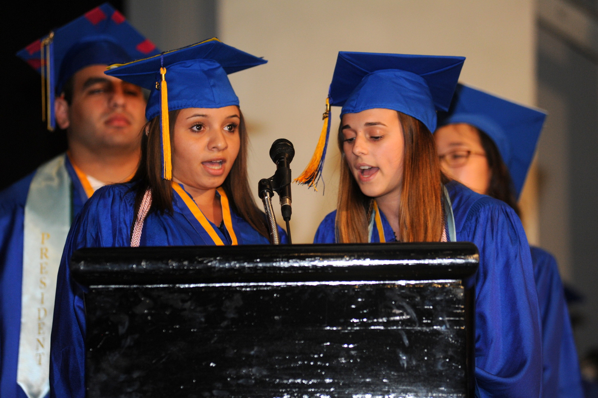 Seniors Gizzel George and Patricia Magliaro sang the national anthem at their graduation at the Tilles Center.