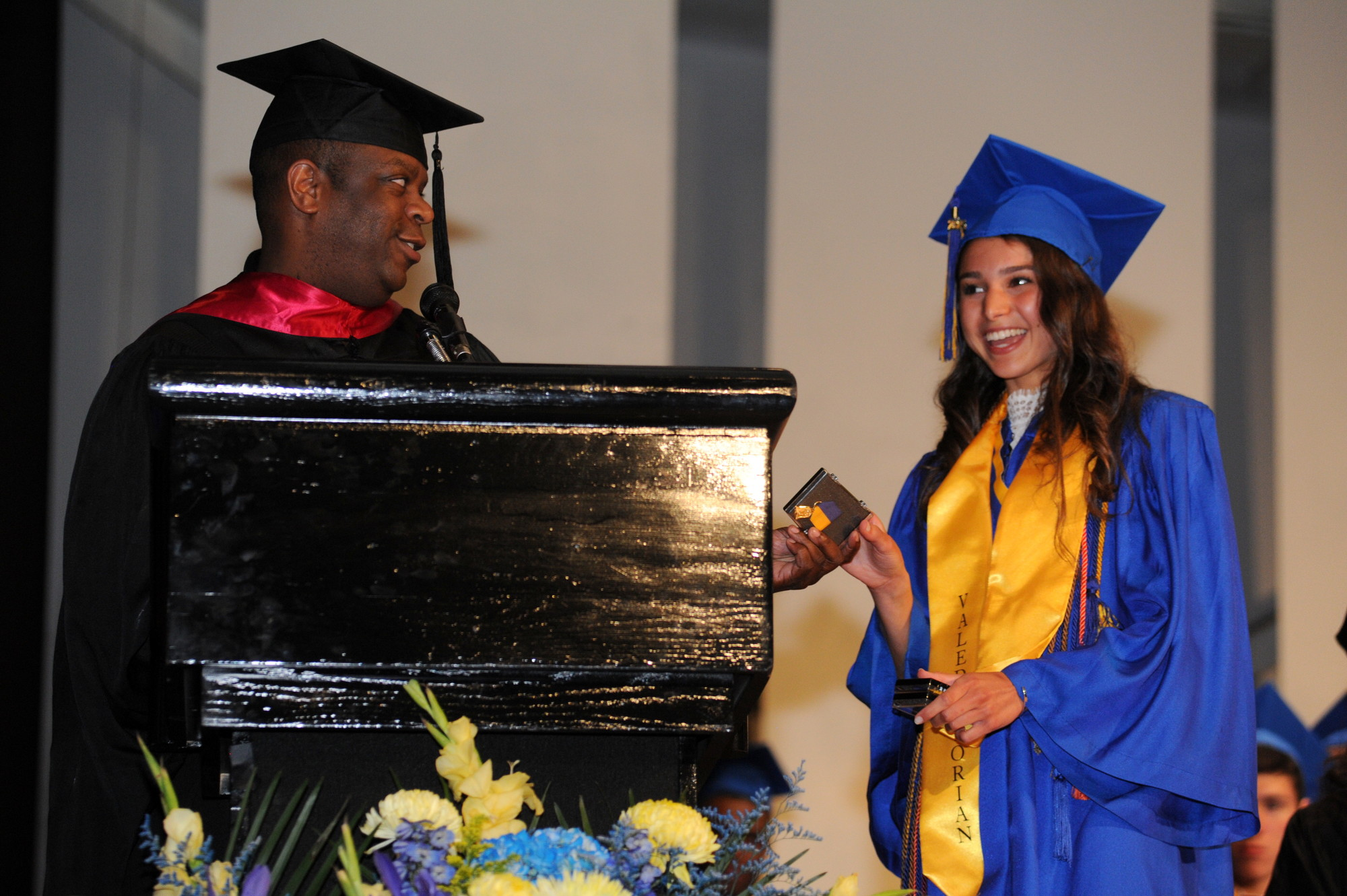 Class of 2015 valedictorian Victoria DeCeglio was presented an award by Math and Science Chairman Bill Moss.