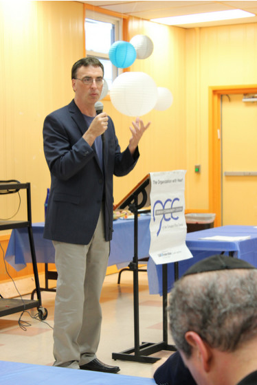 Executive Director Joel Block of the JCC of the Greater Five Towns spoke about the organization's mission at its annual board meeting and volunteer recognition meeting.