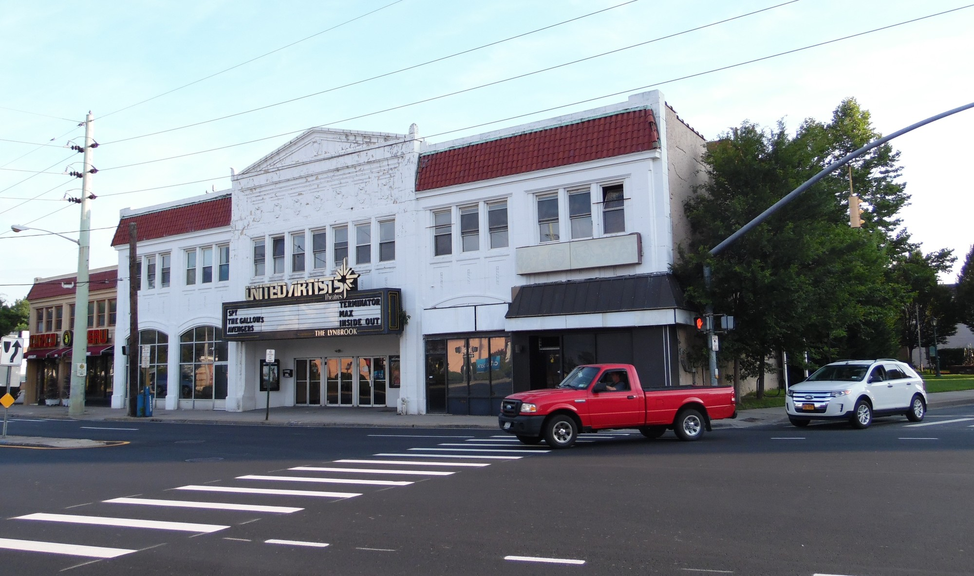 The United Artists theater, owned by Regal Cinemas, will be torn down to make room for a new, taller structure. The small Patrick Henry Park is pictured next to the theater, at right.