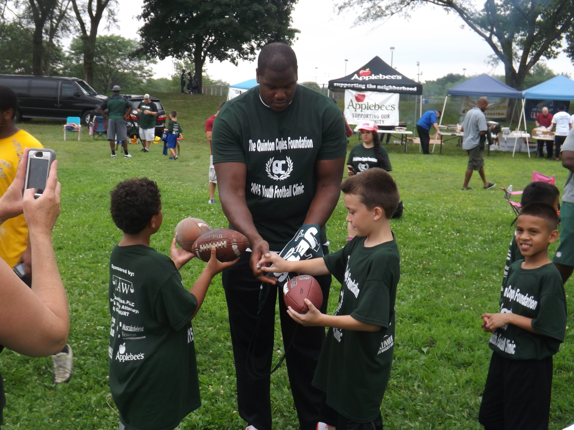 D'Brickashaw Ferguson, a Jets offensive lineman from Freeport, signed dozens of autographs at the event.
