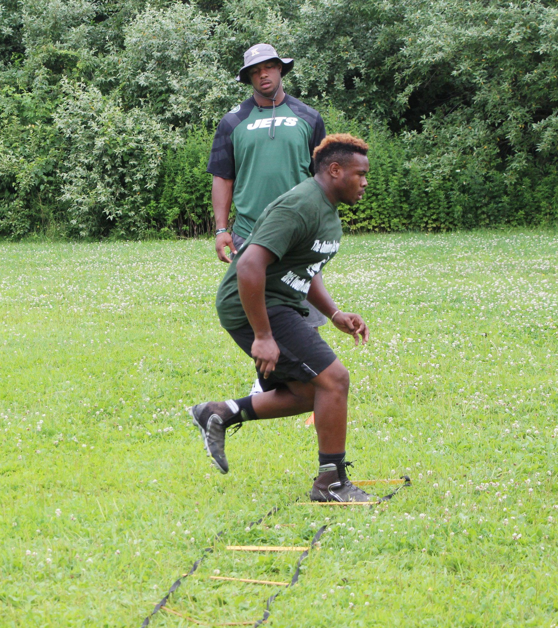 Baldwin High School football player Jahcorie Norworthy worked on his footwork as Coples watched.
