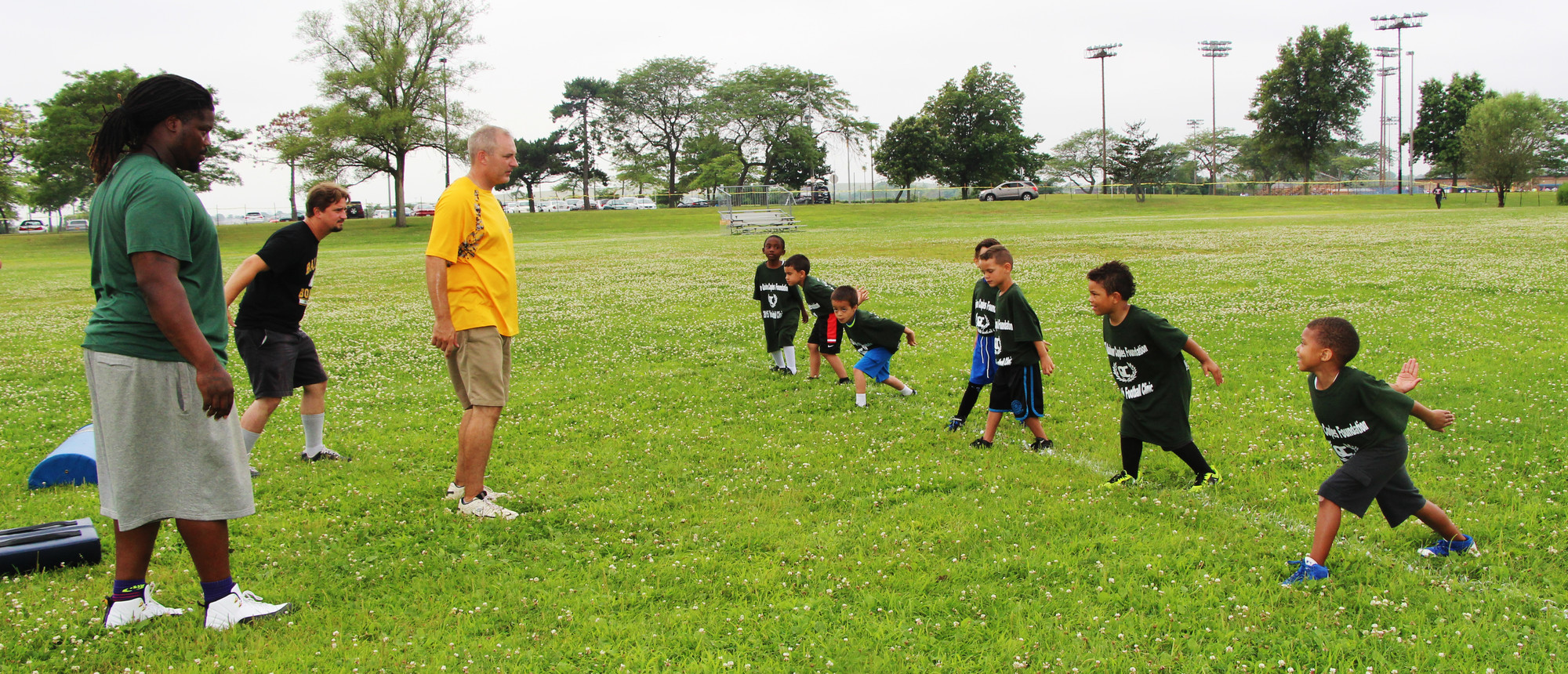 A group of 5-and 6-year-olds practiced tackling with help from Jets defensive tackle Damon Harrison and Baldwin Bombers coaches Michael Jordon, center, and Tom Reilly.